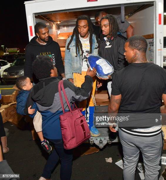 Takeoff and Quavo of the Group Migos hand out Turkeys at The Migos Turkey Drive at 799 Hutchins Road on November 17 2017 in Atlanta Georgia