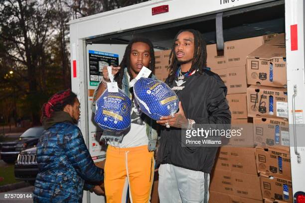 Takeoff and Quavo of The Migos attend The Migos Turkey Drive at 799 Hutchins Road on November 17 2017 in Atlanta Georgia