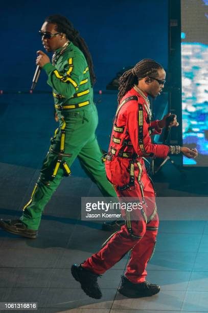 Takeoff and Quavo of the music group Migos perform on stage at American Airlines Arena on November 13 2018 in Miami Florida