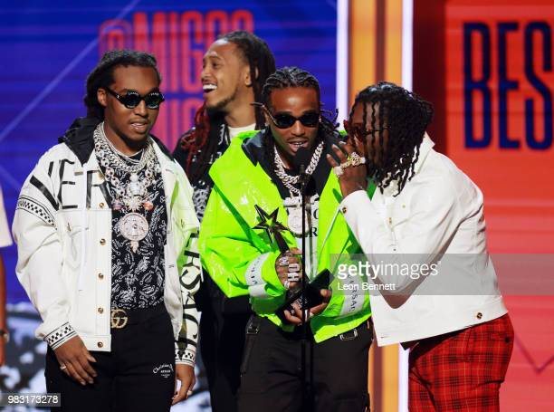 Takeoff Quavo and Offset of Migos accept the Best Group Award onstage at the 2018 BET Awards at Microsoft Theater on June 24 2018 in Los Angeles...