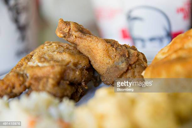 KFC takeout food is arranged for a photograph in Tiskilwa Illinois US on Thursday Oct 1 2015 Yum Brands Inc owner of restaurant brands KFC Pizza Hut...