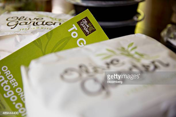 A takeout order and menu from a Darden Restaurants Inc Olive Garden location is arranged for a photograph in Tiskilwa Illinois US on Tuesday Sept 1...