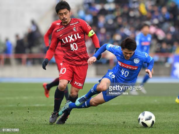 Takeru Kishimoto of Mito HollyHock and Mitsuo Ogasawara of Kashima Antlers compete for the ball during the preseason friendly match between Mito...
