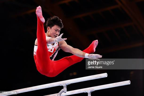 Takeru Kitazono of Team Japan competes on parallel bars during the Men's Team Final on day three of the Tokyo 2020 Olympic Games at Ariake Gymnastics...
