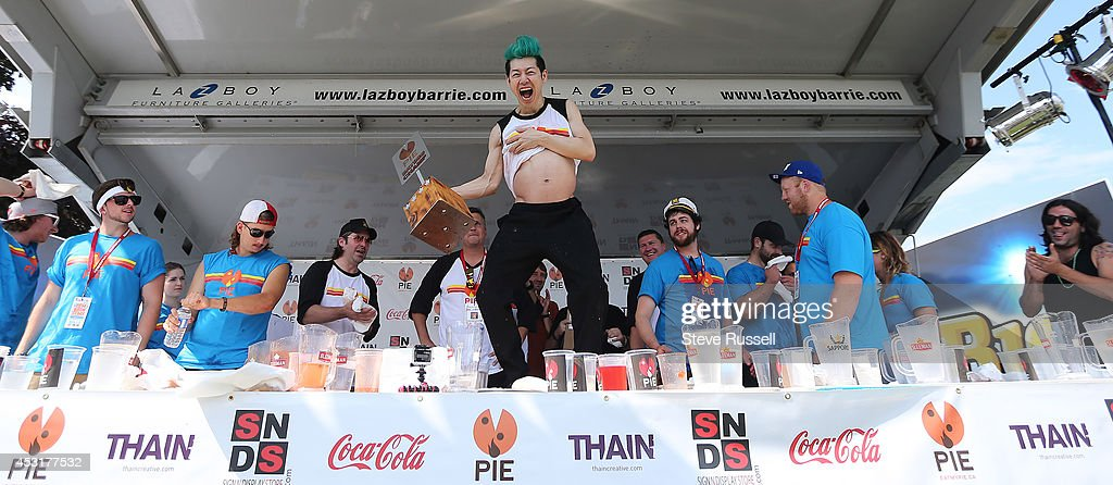 Takeru Kobayashi defends his pizza eating title at 'Let Them Eat 5' During Kempenfest on the waterfront in Barrie, Ontario, Canada.  Kobayashi ate 62 slices of pizza, (15 and a half 12' pizzas, that weigh about a pound each) : News Photo