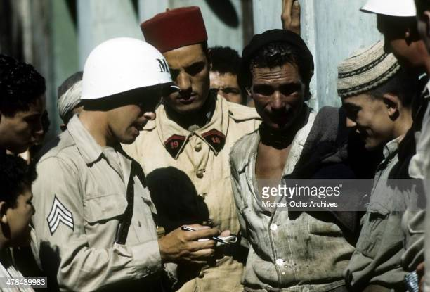 Takes information in the Casbah of Algiers, Algeria. Off limits to US servicemen and patrolled by Military Police, French and Algerian Police.