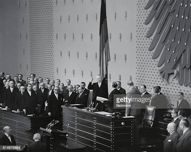 Takes Oath Bonn West Germany Raising his hand and swearing on the constitution West German chancellor Konrad Adenauer is sworn in for his third term...