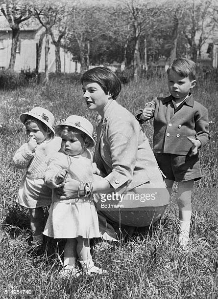 Takes Time Out from Burning Rome Still wearing her Joan of Arc hairdo Swedishborn actress Ingrid Bergman takes her children into the warm sunshine at...