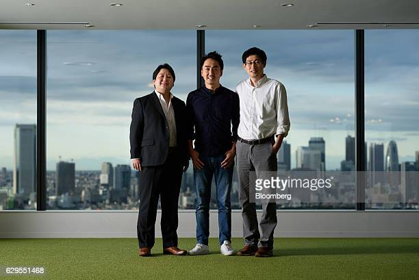 Takeshi Idezawa chief executive officer of Line Corp center Jun Masuda chief strategy and marketing officer left and Joongho Shin chief global...