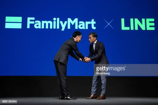 Takeshi Idezawa chief executive officer of Line Corp left and Takashi Sawada president of FamilyMart Co shake hands at Line Corp's annual strategy...