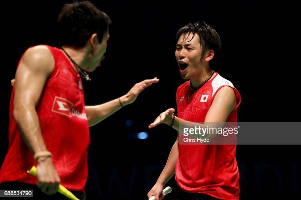 Takeshi Kamura and Keigo Sonoda of Japan celebrate a point in their Quarter Final match against Goh V Shem and Tan Wee Kiong of Malaysia during the...