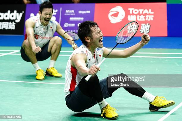 Takeshi Kamura and Keigo Sonoda of Japan celebrate after defeating Marcus Fernaldi Gideon and Kevin Sanjaya Sukamuljo of Indonesia in their Men's...