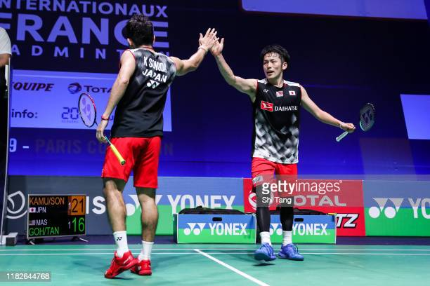 Takeshi Kamura and Keigo Sonoda of Japan celebrate the victory in the Men's Doubles first round match against Goh V Shem and Tan Wee Kiong of...