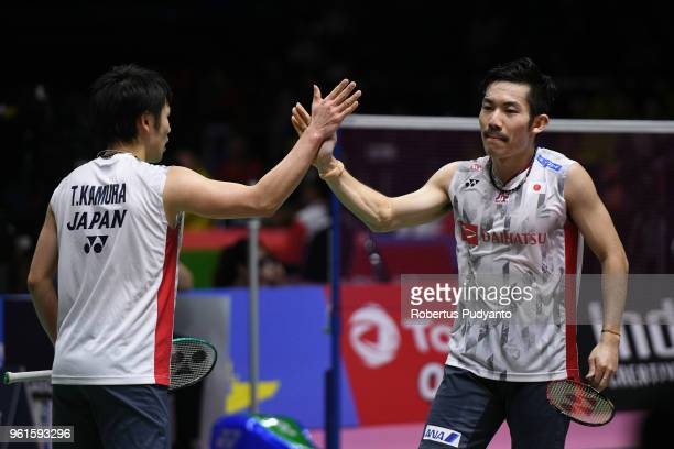 Takeshi Kamura and Keigo Sonoda of Japan celebrate victory after beating Lee Jhe Huei and Lee Yang of Chinese Taipei during Preliminary Round on day...