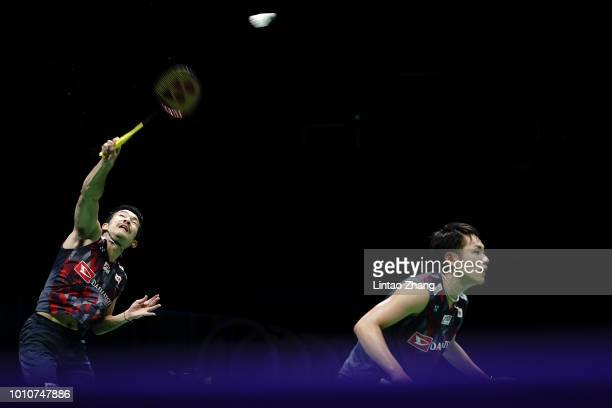 Takeshi Kamura and Keigo Sonoda of Japan compete against Chen Hung Ling and Wang ChiLin of Taiwan in their men's doubles semifinal match during the...