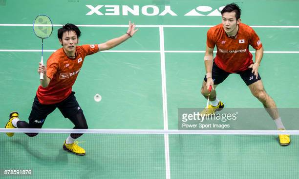 Takeshi Kamura and Keigo Sonoda of Japan compete against Kim Astrup and Anders Skaarup Rasmussen of Denmark during their men doubles round 32 match...