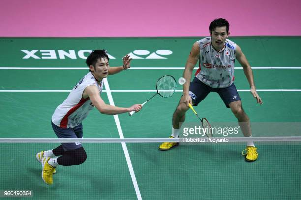 Takeshi Kamura and Keigo Sonoda of Japan compete against Lee Chun Hei Reginald and Or Chin Chung of Hong Kong during qualification match on day one...