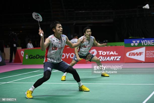 Takeshi Kamura and Keigo Sonoda of Japan compete against Lee Jhe Huei and Lee Yang of Chinese Taipei during Preliminary Round on day four of the BWF...