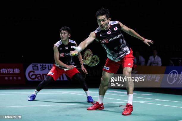 Takeshi Kamura and Keigo Sonoda of Japan compete in the Men's Double final match against Marcus Fernaldi Gideon and Kevin Sanjaya Sukamuljo of...