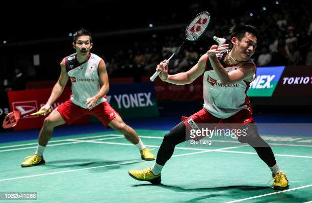 Takeshi Kamura and Keigo Sonoda of Japan compete in the Men's Doubles second round match against Kim Won Ho and Seo Seung Jae of Korea on day three...
