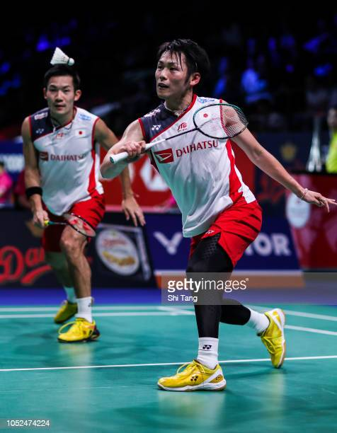 Takeshi Kamura and Keigo Sonoda of Japan compete in the Men's Doubles second round match against Chen Hung Ling and Wang ChiLin of Chinese Taipei on...