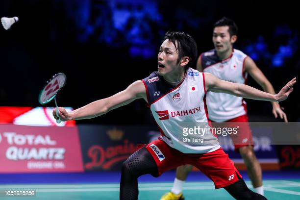 Takeshi Kamura and Keigo Sonoda of Japan compete in the Men's Doubles semi finals match against Marcus Ellis and Chris Langridge of England on day...