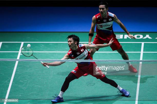 Takeshi Kamura and Keigo Sonoda of Japan compete in the Men's Doubles first round match against Mohamad Arif Ab Latif Arif and Nur Mohd Azriyn Ayub...