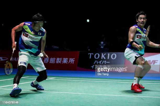 Takeshi Kamura and Keigo Sonoda of Japan compete in the Men's Doubles second round match against Lee Yang and Wang ChiLin of Chinese Taipei during...