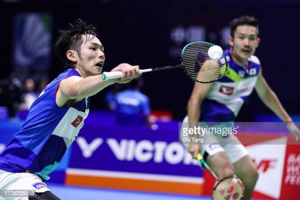 Takeshi Kamura and Keigo Sonoda of Japan compete in the Men's Doubles first round match against Goh Sze Fei and Nur Izzuddin of Malaysia on day one...