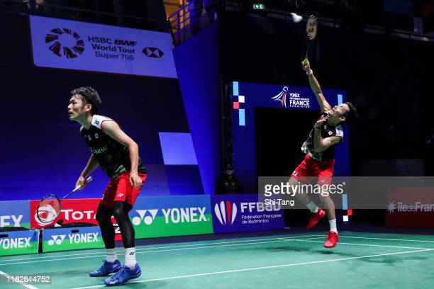 Takeshi Kamura and Keigo Sonoda of Japan compete in the Men's Doubles first round match against Goh V Shem and Tan Wee Kiong of Malaysia on day one...