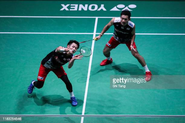 Takeshi Kamura and Keigo Sonoda of Japan compete in the Men's Doubles second round match against Lee Yang and Wang ChiLin of Chinese Taipei on day...