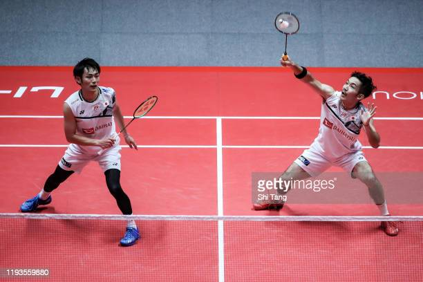 Takeshi Kamura and Keigo Sonoda of Japan compete in the Men's Doubles round robin match against Li Junhui and Liu Yuchen of China during day two of...