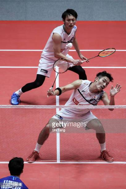 Takeshi Kamura and Keigo Sonoda of Japan compete in the Men's Doubles round robin match against Marcus Fernaldi Gideon and Kevin Sanjaya Sukamuljo of...