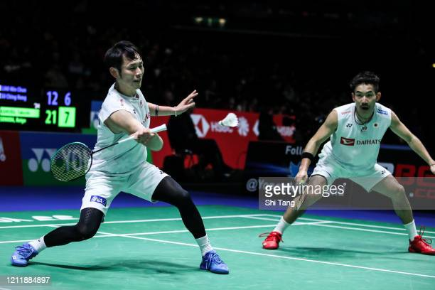 Takeshi Kamura and Keigo Sonoda of Japan compete in the Men's Doubles first round match against Liao Min Chun and Su Ching Heng of Chinese Taipei on...