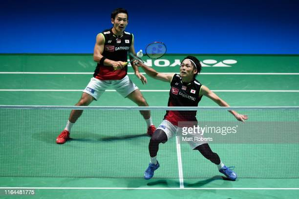 Takeshi Kamura and Keigo Sonoda of Japan competes in the Men's Doubles semifinal match against Mohammad Ahsan and Hendra Setiawan of Indonesia on day...