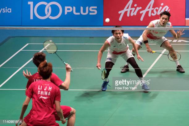 Takeshi Kamura and Keigo Sonoda of Japan in action against Li Junhui and Liu Yuchen of China in the men double final on day six of the Badminton...