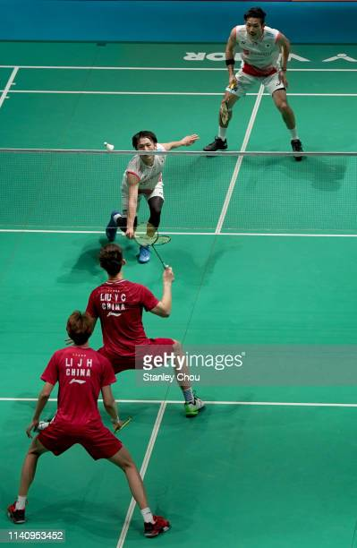 Takeshi Kamura and Keigo Sonoda of Japan in action against Li Junhui and Liu Yuchen of China in the men's doubles on day six of the Badminton...