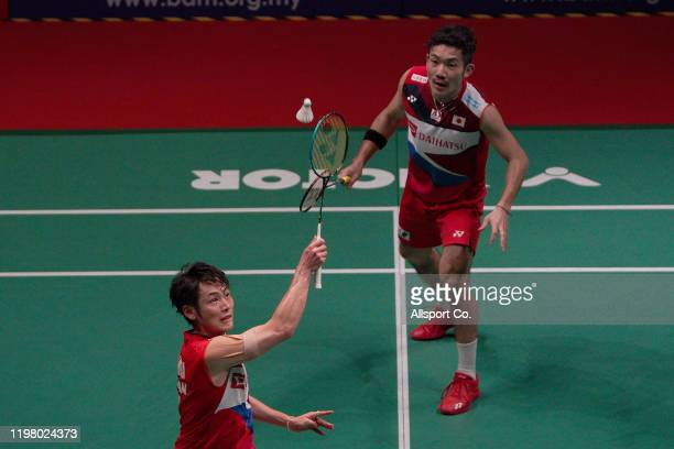Takeshi Kamura and Keigo Sonoda of Japan in action during the Men's Double during the qualification round of the Malaysia Master at the Axiata Arena...