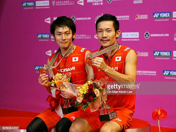 Takeshi Kamura and Keigo Sonoda of Japan poses with their medals after defeating Mathias Boe and Carsten Mogensen of Denmark at Men's Double Final at...