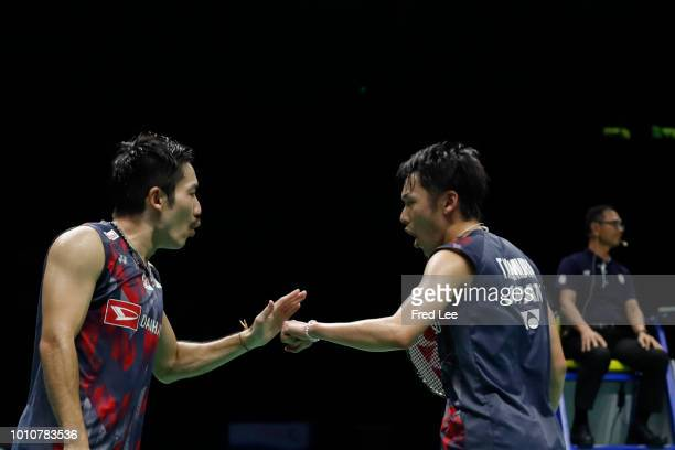 Takeshi Kamura and Keigo Sonoda of Japan react as they defeat Chen Hung Ling and Wang ChiLin of Taiwan in their men's doubles semifinal match during...