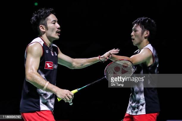 Takeshi Kamura and Keigo Sonoda of Japan react in the Men's Double final match against Marcus Fernaldi Gideon and Kevin Sanjaya Sukamuljo of...