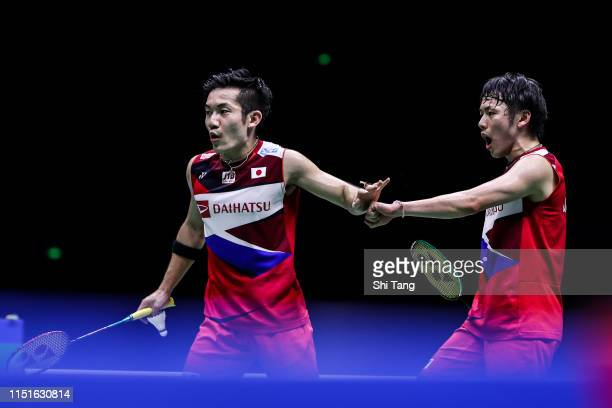 Takeshi Kamura and Keigo Sonoda of Japan react in the Men's Doubles semi finals match against Marcus Fernaldi Gideon and Kevin Sanjaya Sukamuljo of...