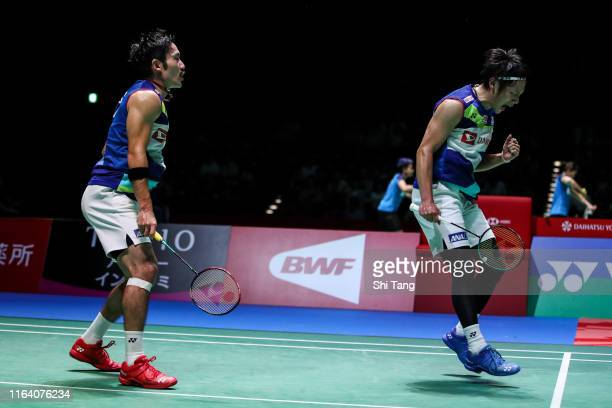 Takeshi Kamura and Keigo Sonoda of Japan react in the Men's Doubles second round match against Lee Yang and Wang ChiLin of Chinese Taipei during day...