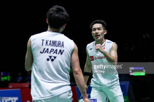 Takeshi Kamura and Keigo Sonoda of Japan react in the Men's Doubles first round match against Liao Min Chun and Su Ching Heng of Chinese Taipei on...