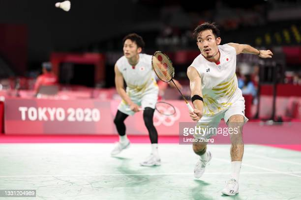 Takeshi Kamura and Keigo Sonoda of Team Japan compete against Mohammad Ahsan and Hendra Setiawan of Team Indonesia during a Men's Doubles...