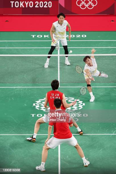 Takeshi Kamura and Keigo Sonoda of Team Japan compete against Li Jun Hui and Liu Yu Chen of Team China during a Men's Doubles Group C match on day...