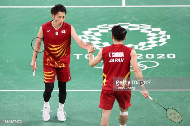 Takeshi Kamura and Keigo Sonoda of Team Japan react as they compete against Philip Chew and Ryan Chew of Team United States during a Men's Doubles...