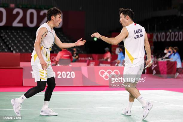 Takeshi Kamura and Keigo Sonoda of Team Japan react as they compete against Li Jun Hui and Liu Yu Chen of Team China during a Men's Doubles Group C...