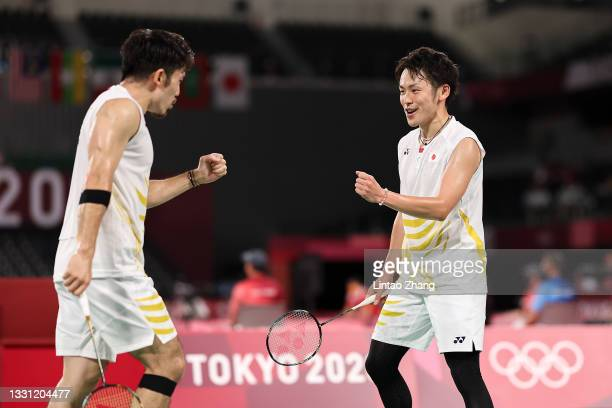 Takeshi Kamura and Keigo Sonoda of Team Japan react as they compete against Mohammad Ahsan and Hendra Setiawan of Team Indonesia during a Men's...
