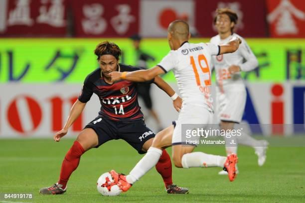 Takeshi Kanamori of Kashima Antlers and Ryo Okui of Omiya Ardija compete for the ball during the J.League J1 match between Kashima Antlers and Omiya...